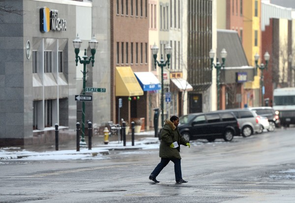 After a couple of inches of snow fell, the sun shines on Genesee Street in downtown Auburn.