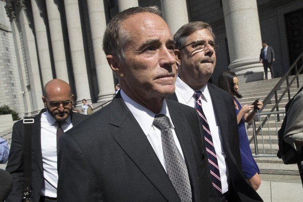 Republican U.S. Rep. Christopher Collins leaves federal court on Wednesday.  (Mary Altaffer | AP Photo)