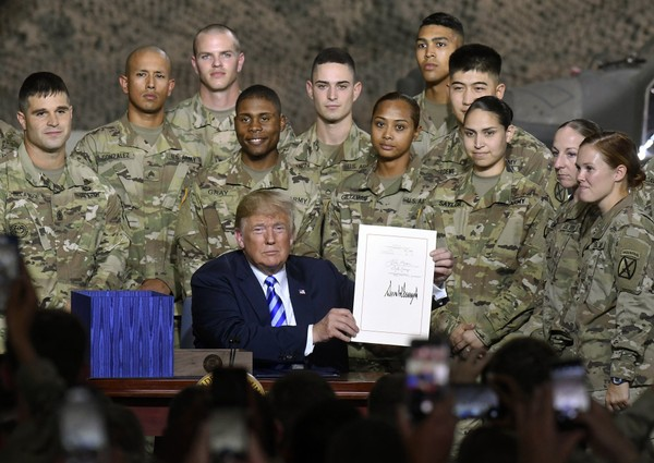 president donald trump signs the john s mccain national defense authorization act for the fiscal