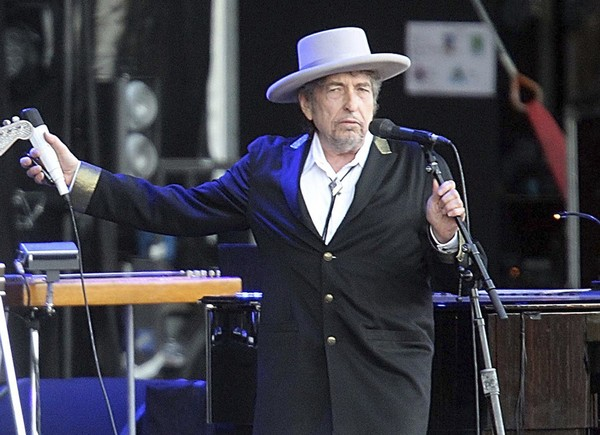 """This July 22, 2012, file photo shows U.S. singer-songwriter Bob Dylan performing onstage at """"Les Vieilles Charrues"""" Festival in Carhaix, western France. (David Vincent 
