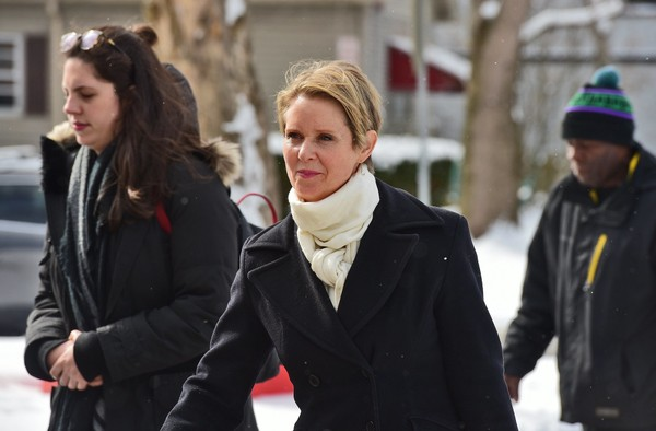 Actress Cynthia Nixon, at center, walks towards the Southwest Community Center in Syracuse, Thursday April 5, 2018. She is challenging Gov. Andrew Cuomo to a September Democratic Party primary. Photo by Michael Greenlar | mgreenlar@syracuse.com