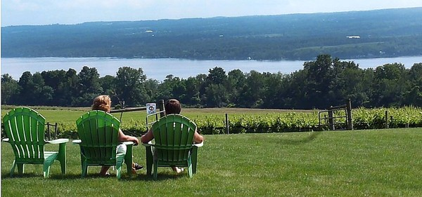 Visitors enjoy the view of Cayuga Lake at Long Point Winery in Aurora.