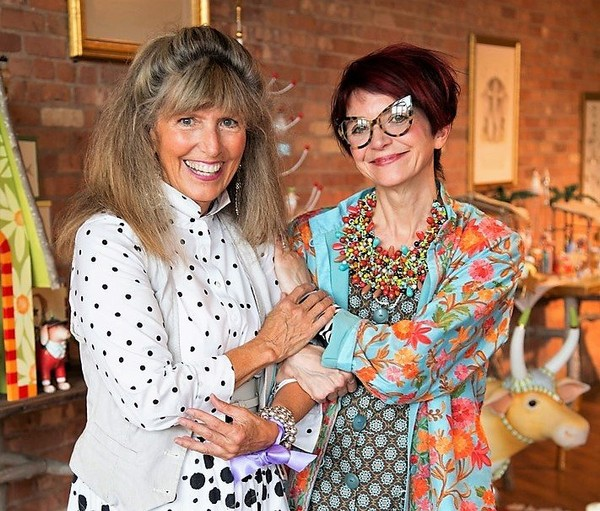 Designer Patience Brewster, left, and Rebecca Proctor, creative director and chief brand officer of MacKenzie-Childs. Aurora-based MacKenzie-Childs has acquired Skaneateles-based Patience Brewster Inc., which makes whimsical ornaments.  (Courtesy of MacKenzie-Childs)