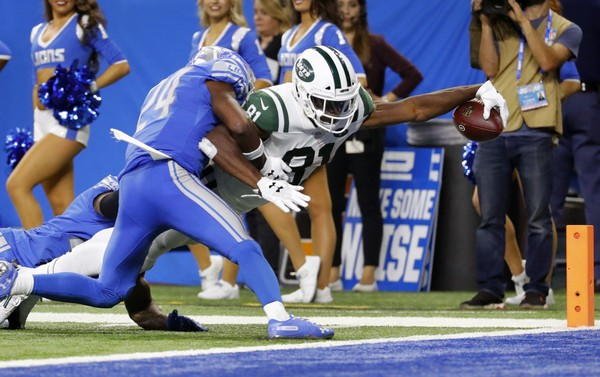 New York Jets wide receiver Quincy Enunwa (81) reaches to score on a 21-yard touchdown reception as Detroit Lions defensive back Nevin Lawson (24) defends during the second half of an NFL football game in Detroit, Monday, Sept. 10, 2018. (AP Photo/Rick Osentoski)(Rick Osentoski)
