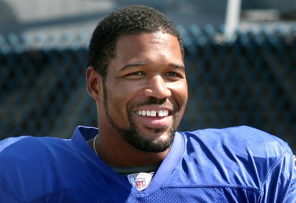 New York Giants' Michael Strahan smiles as he walks to the football practice field near Giants Stadium, Tuesday, Sept. 4, 2007, in East Rutherford, N.J.