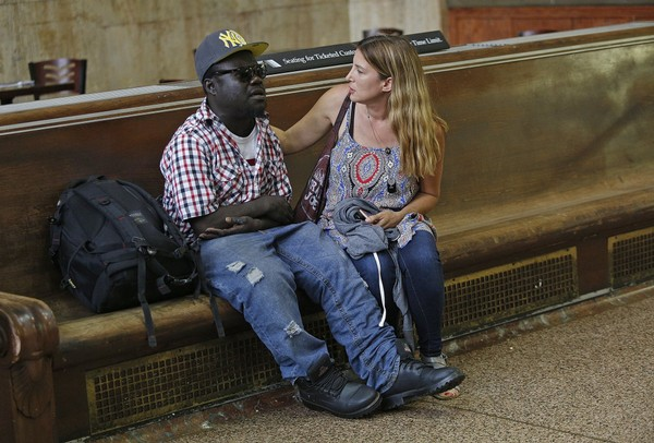 Jenny DePaul checks in with Patrick Boima inside Newark Penn Station. About 28 percent of Newark residents lived in poverty in 2017, according to the U.S. Census Bureau.