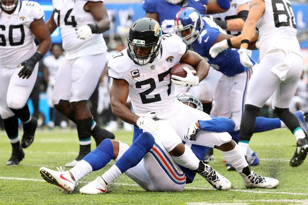 Leonard Fournette of the Jacksonville Jaguars runs with the ball against New York Giants in the first quarter at MetLife Stadium Sunday in East Rutherford, N.J.