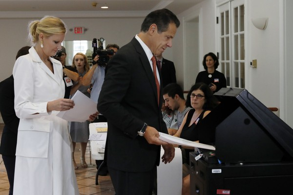 New York Gov. Andrew Cuomo, accompanied by his girlfriend Sandra Lee, puts his primary election ballot in a scanner at the Presbyterian Church of Mount Kisco, in Mt. Kisco, NY, Thursday, Sept. 13, 2018. (AP Photo/Richard Drew)
