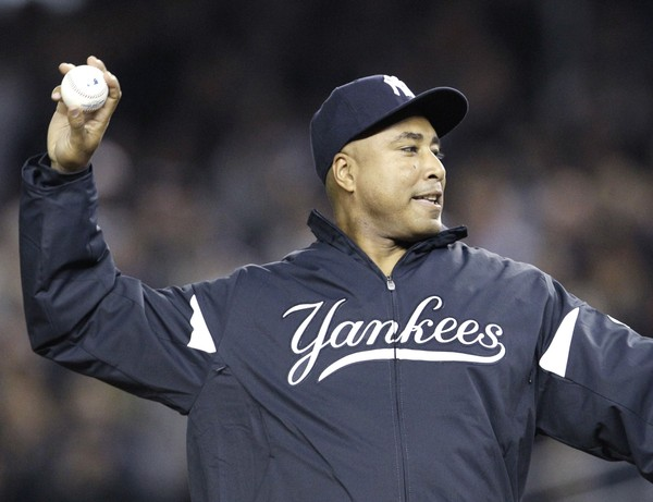 Former New York Yankees outfielder Bernie Williams throws out a ceremonial pitch before Game 4 of baseball's American League Championship Series between the Yankees and Texas Rangers Tuesday, Oct. 19, 2010, in New York.