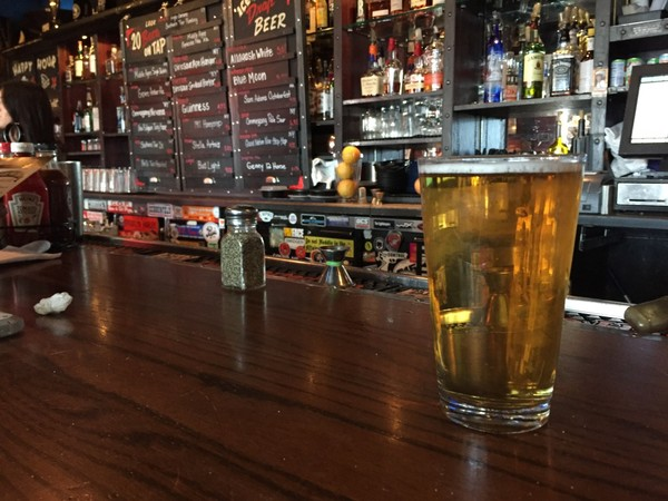 A pint of Genesee 12 Horse Ale at the Dinosaur Bar-B-Que in Syracuse. The beer is making a limited comeback across Upstate New York this month, and is featured in a charitable promotion at the four Dinosaur locations. (Don Cazentre)