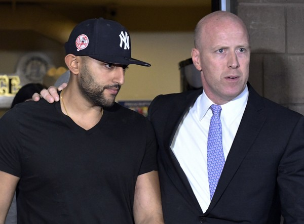 Nauman Hussain, left, leaves Cobleskill Town court with his attorney Lee Kindlon after arraignment Wednesday, Oct. 10, 2018. The limousine service operator, Hussain, was charged Wednesday with criminally negligent homicide in a crash that killed 20 people, while police continued investigating what caused the wreck and whether anyone else will face charges. (AP Photo/Hans Pennink)(Hans Pennink)