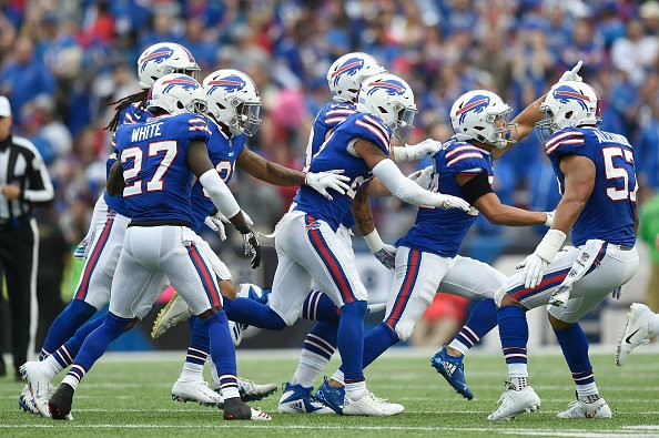 BUFFALO, NY - OCTOBER 07: Cornerback Taron Johnson #24 of the Buffalo Bills celebrates with his teammates after catching an interception in the second quarter against the Tennessee Titans at New Era Field on October 7, 2018 in Buffalo, New York. (Photo by Patrick McDermott/Getty Images)
