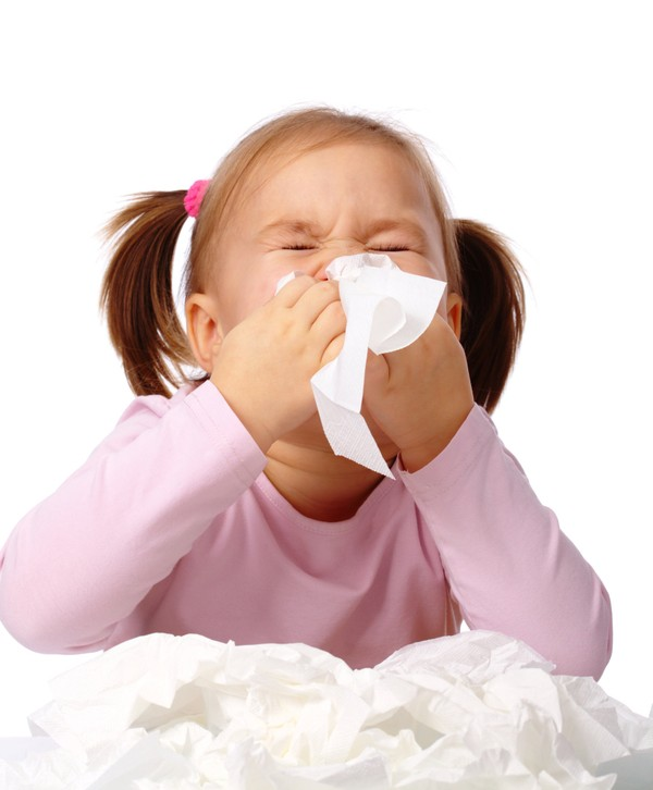 A child blows her nose.