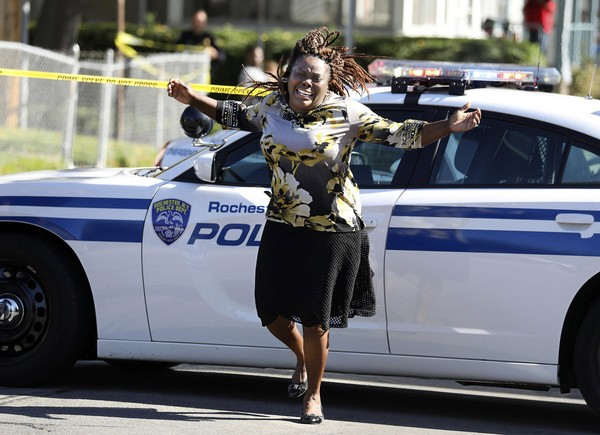 Juliet Blake-Lavan of Rochester, the aunt of a shooting suspect, reacts to news that the man was killed in a shootout with police earlier this week.  (Shawn Dowd | Democrat & Chronicle via AP)