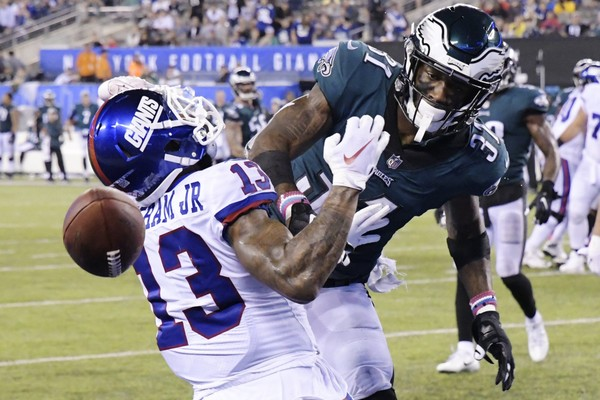 Philadelphia Eagles' Jalen Mills (31) defends against New York Giants' Odell Beckham (13) during the second half of an NFL football game Thursday, Oct. 11, 2018, in East Rutherford, N.J. The Eagles won 34-13.