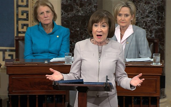 In this image from video provided by Senate TV, Sen. Susan Collins, R-Maine., speaks on the Senate floor about her vote on Supreme Court nominee Judge Brett Kananaugh, Friday, Oct. 5, 2018 in the Capitol in Washington. Sen Shelly Capito, R-W.Va., sits rear left and Sen. Cindy Hyde-Smith, R-Miss., sits right. (Senate TV via AP) (AP)