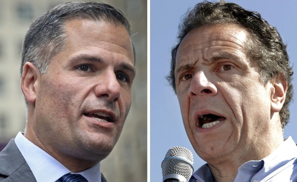 In this combination photo, New York Republican gubernatorial candidate Marc Molinaro, left, speaks at a news conference in New York on Sept. 14, 2018, and New York Gov. Andrew Cuomo, right, speaks a news conference in in Tarrytown; N.Y., on May 8, 2018. (AP Photos/Bebeto Matthews, left, and Julio Cortez, Files)