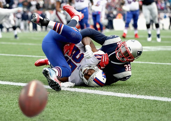 FOXBORO, MA - DECEMBER 24: Devin McCourty #32 of the New England Patriots breaks up a pass intended for LeSean McCoy #25 of the Buffalo Bills during the second quarter of a game at Gillette Stadium on December 24, 2017 in Foxboro, Massachusetts. (Photo by Adam Glanzman/Getty Images)(Adam Glanzman)