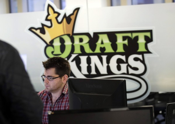 In this Thursday, Jan. 11, 2018, file photo, employees work at the DraftKings office in Boston. The explosion in popularity of daily fantasy sports over the last decade has created a generation of sports fans more attuned to gauging individual player statistics than how two teams may fare against each other, the challenge at the heart of traditional sports wagering. (AP Photo/Charles Krupa, File) (Charles Krupa)