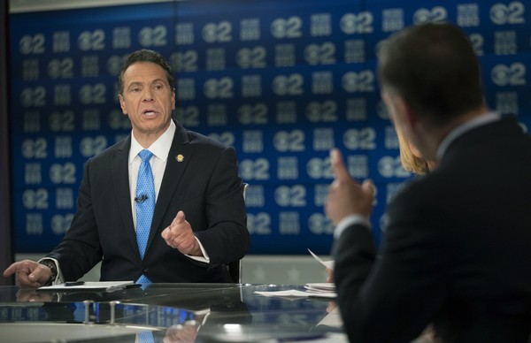 New York Gov. Andrew Cuomo, left, and Republican Marc Molinaro, right, argue during the New York gubernatorial debate hosted by CBS 2 and WCBS Newsradio 880, Tuesday, Oct. 23, 2018, in New York City. (Mary Altaffer | AP)