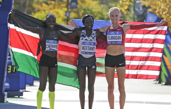 Second place finisher Vivian Cheruiyot of Kenya, left, first place finisher Mary Keitany of Kenya, center, and third place finisher Shalane Flanagan of the United States pose for a picture at the finish line of the New York City Marathon in New York, Sunday, Nov. 4, 2018. (AP Photo/Seth Wenig) AP
