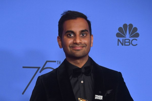 """In this photo taken on January 7, 2018, """"Master of None"""" actor Aziz Ansari poses with the trophy for Best Performance by an Actor in a Television Series - Musical or Comedy during the 75th Golden Globe Awards in Beverly Hills, California.(Frederic J. Brown 