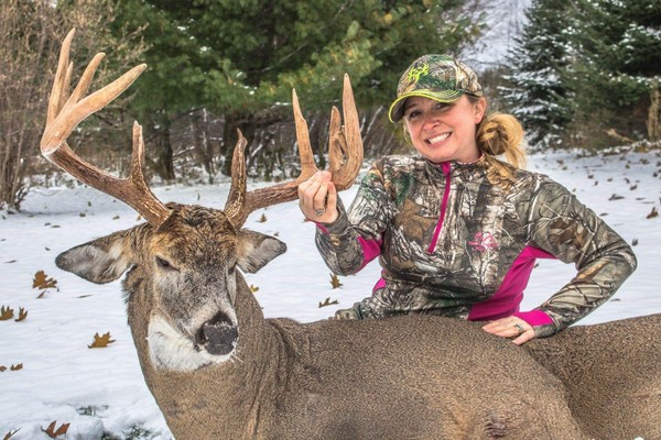 """Deanna Nikiel is all smiles -- and for good reason. She shot this massive 10-point buck with kickers with her crossbow on Nov. 11 in her hometown of Bennington, N.Y. in Wyoming County. It was a 25-yard shot, she said, adding it had a """"Trophy Tape"""" score of 152 1/4 inches."""