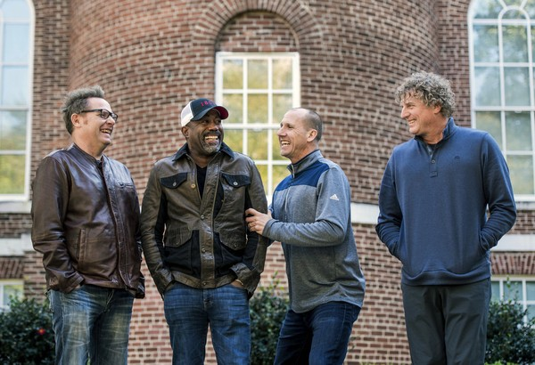 "In this Nov. 16, 2018 photo, Dean Felber, from left, Darius Rucker, Jim Sonefeld, and Mark Bryan, of Hootie & the Blowfish, pose for a portrait at the University of South Carolina in Columbia, S.C. The band is returning with a tour and album 25 years after ""Cracked Rear View"" launched the South Carolina-based rock band."