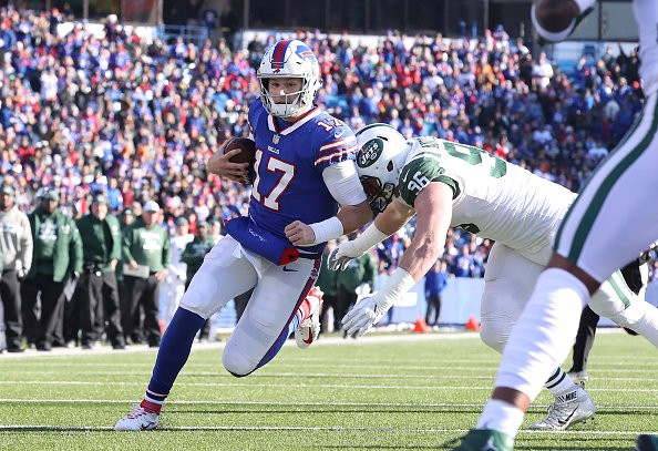 Josh Allen of the Buffalo Bills runs into the end zone for the touchdown in the first quarter against the New York Jets on Sunday at New Era Field.