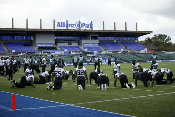 Jacksonville Jaguars players warm up during a training session at Allianz Park in London, Friday Oct. 26, 2018. (Tim Ireland / AP)