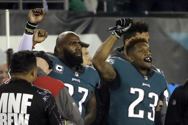 Philadelphia Eagles strong safety Malcolm Jenkins (27) and free safety Rodney McLeod (23) gesture during the playing of the national anthem prior to an NFL football. (Matt Rourke | AP PHOTO)
