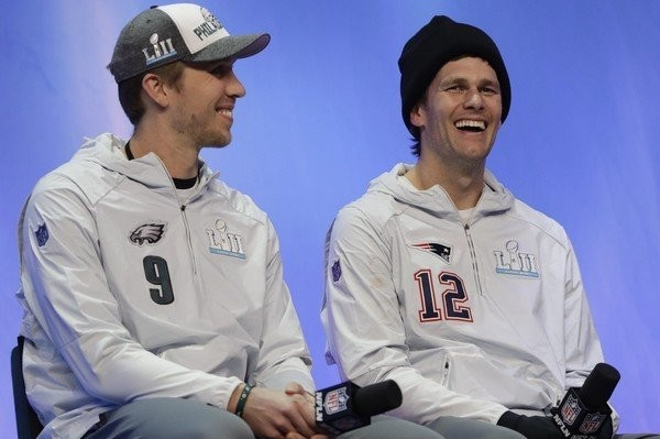 Philadelphia Eagles' Nick Foles and New England Patriots' Tom Brady answer questions during NFL football Super Bowl 52 Opening Night Monday, Jan. 29, 2018, at the Xcel Center in St. Paul, Minn.  (Eric Gay | AP)