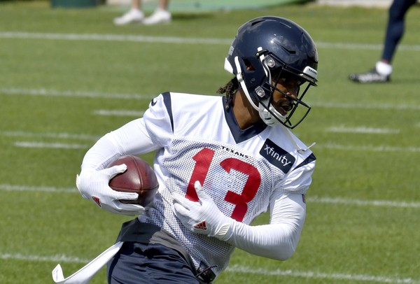 Houston Texans wide receiver Braxton Miller r (13) runs the ball down field during the teams NFL football training camp in White Sulphur Springs, W.Va., Thursday, July 26, 2018.