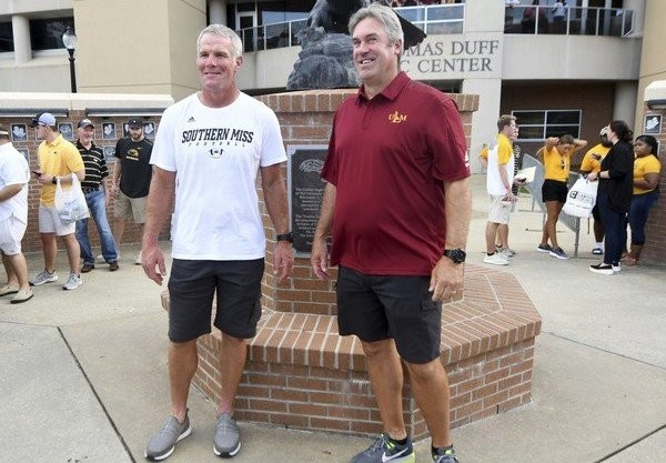 Former Northeast Louisiana player and current Philadelphia Eagles head coach Doug Pederson, right, and former NFL and Southern Mississippi quarterback Brett Favre pose for pictures outside the stadium at an NCAA college football game between Southern Mississippi and Louisiana-Monroe, Saturday, Sept. 8, 2018, in Hattiesburg, Miss.  (Susan Broadbridge | AP)