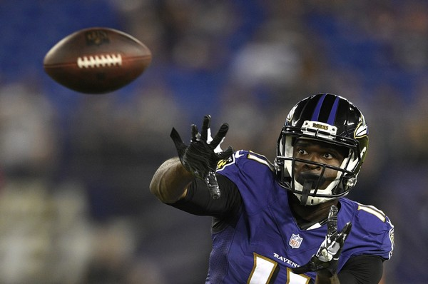Baltimore Ravens wide receiver Breshad Perriman prepares to catch a pass in the second half of a preseason NFL football game against the Los Angeles Rams, Thursday, Aug. 9, 2018, in Baltimore.