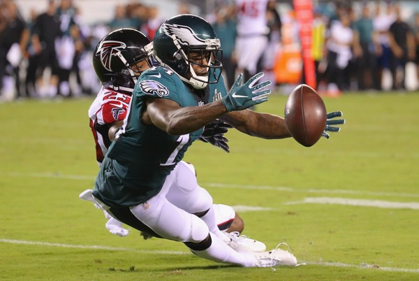 PHILADELPHIA, PA - SEPTEMBER 06:  Mike Wallace #14 of the Philadelphia Eagles attempts to catch the ball as he is defended by Robert Alford #23 of the Atlanta Falcons during the second half at Lincoln Financial Field on September 6, 2018 in Philadelphia, Pennsylvania.