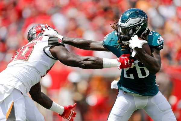 Jay Ajayi #26 of the Philadelphia Eagles stiff arms Jason Pierre-Paul #90 of the Tampa Bay Buccaneers during the first half at Raymond James Stadium on September 16, 2018 in Tampa, Florida. (Michael Reaves | Getty)