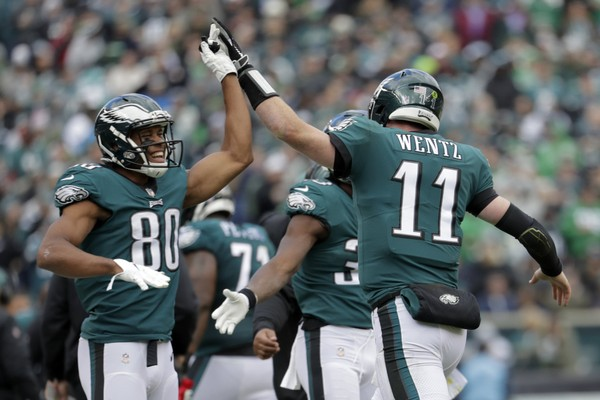 FILE - In this Sunday, Oct. 21, 2018, file photo, Philadelphia Eagles quarterback Carson Wentz (11) and wide receiver Jordan Matthews (80) celebrate Wentz's touchdown pass to wide receiver Alshon Jeffery during the first half of an NFL football game against the Carolina Panthers, in Philadelphia. The Eagles face the Jacksonville Jaguars on Sunday, Oct. 28. (AP Photo | Michael Perez, File)