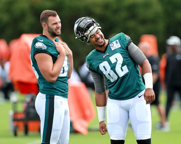 Eagles TE Richard Rodgers (82) talk to Eagles TE Dallas Goedert (88) during open day of training camp at the NovaCare Complex in Philadelphia, Thursday, July 26, 2018. Tim Hawk | For NJ.com