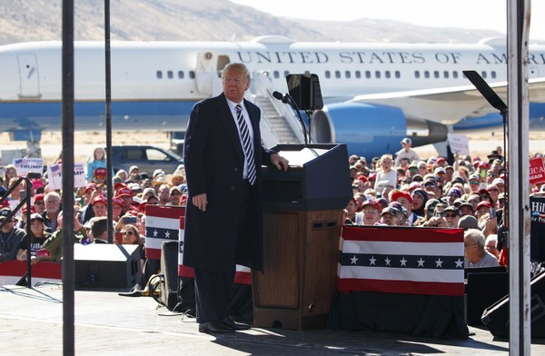 President Donald Trump pauses as he speaks during a campaign rally at Elko Regional Airport, Saturday, Oct. 20, 2018, in Elko, Nev.