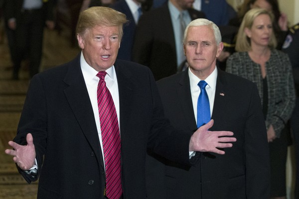 President Donald Trump, accompanied by Vice President Mike Pence, arrives for a Senate Republican Policy luncheon on Capitol Hill in Washington, Wednesday, Jan. 9, 2019. (AP Photo/Alex Brandon)