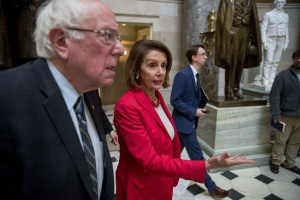 Sen. Bernie Sanders, I-Vt., left, and House Speaker Nancy Pelosi of Calif., center, walk to an event with furloughed federal workers amid the partial government shutdown, Wednesday, Jan. 16, 2019, on Capitol Hill in Washington. (AP Photo/Andrew Harnik)