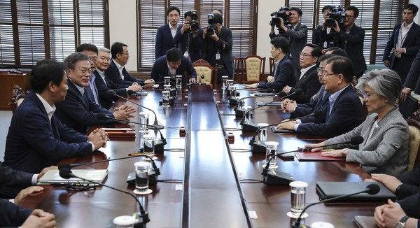 South Korean President Moon Jae-in, second from left, presides over a meeting with his security ministers, including National Security Advisor Chung Eui-yong, second from right, and National Intelligence Service Director Suh Hoon, third from right, one day before Chung and Suh make a one-day trip to North Korea at the presidential Blue House in Seoul, South Korea, Tuesday, Sept. 4, 2018.