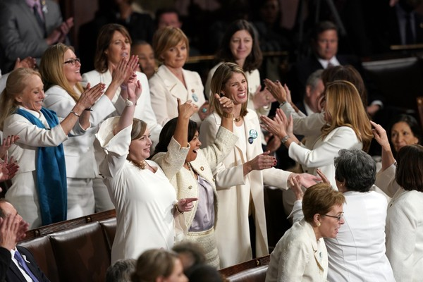 Members of Congress cheer after President Donald Trump acknowledges more women in Congress during his State of the Union address in Washington, Tuesday, Feb. 5, 2019. (AP Photo/Carolyn Kaster)