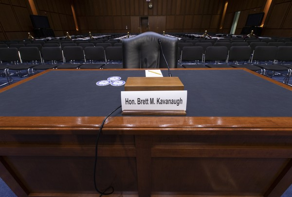 The witness table is prepared for President Trump's Supreme Court nominee, Brett Kavanaugh, in the Senate Judiciary Committee hearing room on Capitol Hill in Washington, Monday, Sept. 3, 2018.