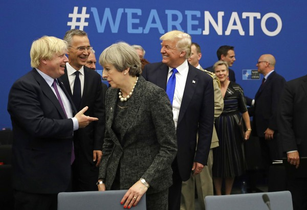 Donald Trump blasts NATO alliance ahead of summit, meeting with Vladimir Putin