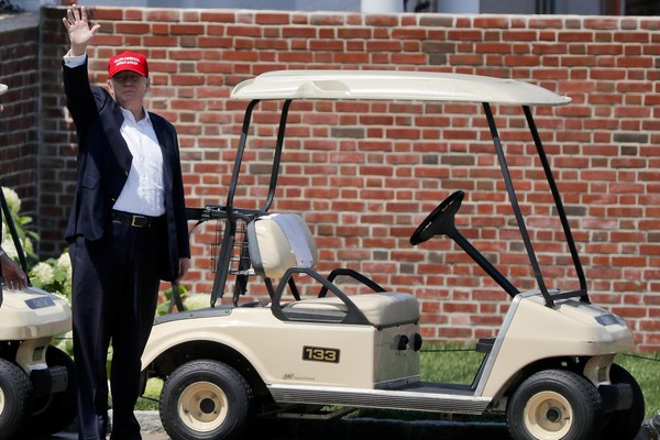 A gunman opened fire at a Trump golf course in Miami Friday morning. The president. shown here at one of his New Jersey golf courses, was not at the club at the time. (AP Photo/Julie Jacobson)