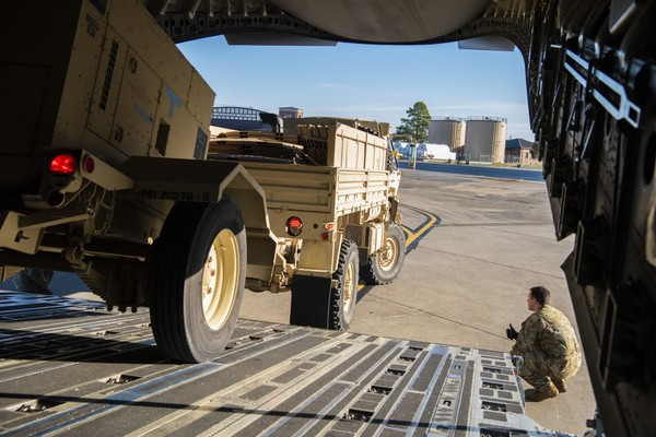 This Oct. 29, 2018 photo provided by the U.S. Air Force shows Airman 1st Class Trevor Pearce helping guide a military vehicle into the cargo compartment of a C-17 Globemaster III at Fort Knox, Kentucky. (Airman 1st Class Zoe Wockenfuss)