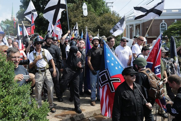 "Hundreds of white nationalists, neo-Nazis, KKK and members of the ""alt-right"" hurl water bottles back and forth against counter demonstrators on the outskirts of Emancipation Park during the Unite the Right rally on Aug. 12, 2017 in Charlottesville, Virginia. (Chip Somodevilla/Getty Images, File)"