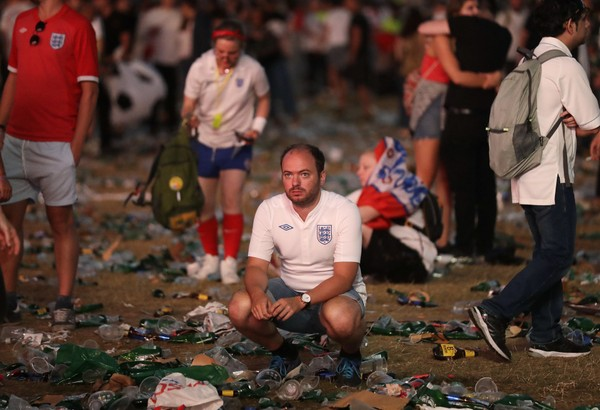 England soccer fans react after losing to Croatia in the 2018 World Cup semifinal match in Hyde Park, London, Wednesday, July 11, 2018. (AP Photo/Matt Dunham)